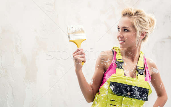 Young woman wearing coverall holding paint brush   Stock photo © amok