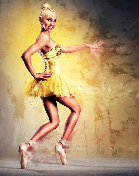 Beautiful ballerina in yellow tutu on point Stock photo © amok
