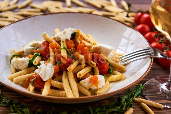 Vegetarian pasta garnished with tomato, cheese and fresh herbs Stock photo © amok