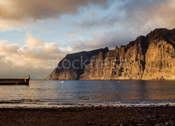 Cliffs of Los Gigantes at sunset. Canary Island, Tenerife. Spain Stock photo © amok