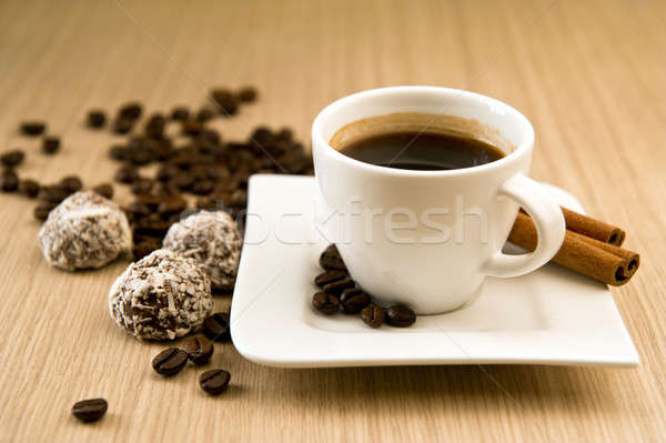 Cup of coffee with beans and truffles over wooden background Stock photo © amok