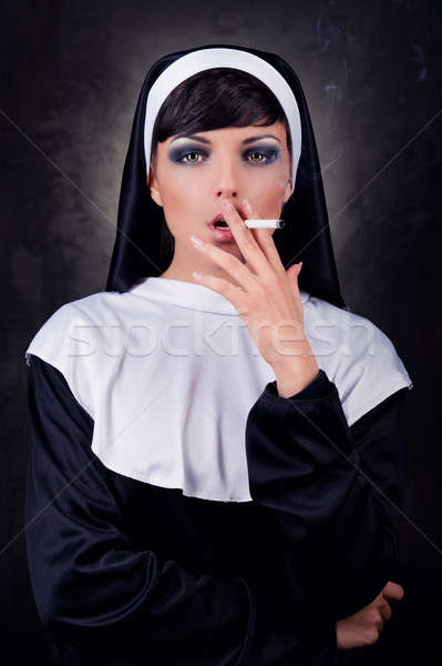 Smoking young nun Stock photo © amok