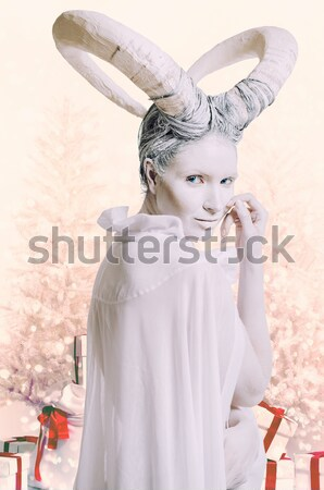 Portrait of female with goat body-art Stock photo © amok