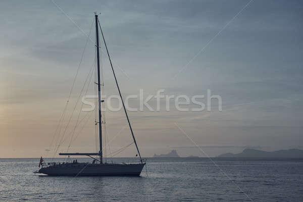 Yacht at Cala Saona in Formentera at sunset. Spain Stock photo © amok