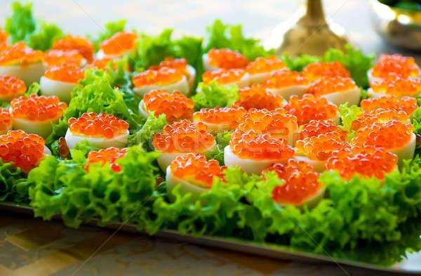 Ripieno uova rosso caviale foglia verde Foto d'archivio © amok