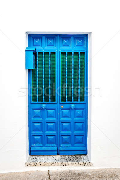 Blue door over white wall. Mijas, Andalusia. Southern Spain Stock photo © amok