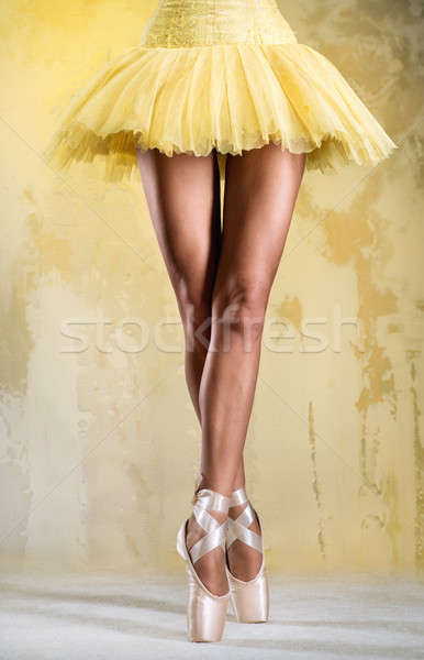 Ballerina on point over obsolete wall Stock photo © amok