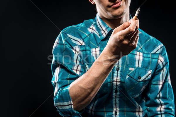 молодым человеком курение сигарету здоровья фон дым Сток-фото © amok