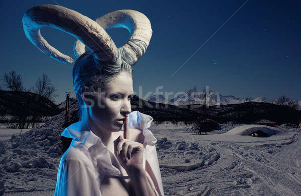 Female with goat body-art over winter countryside background. De Stock photo © amok