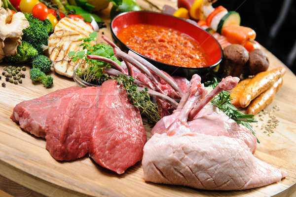Abundance of raw food on a wooden board Stock photo © amok