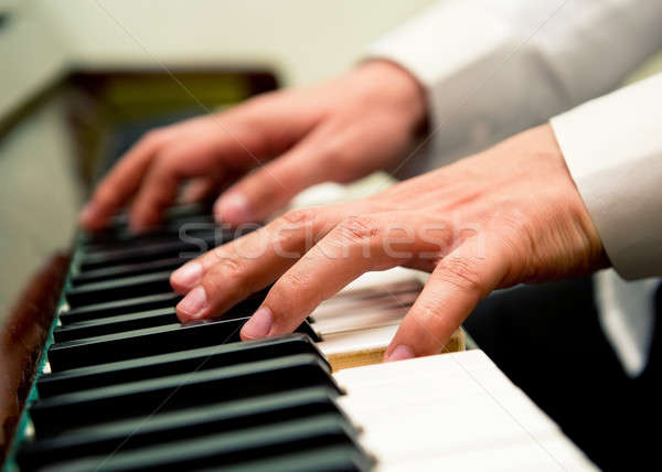 Male hands playing the piano Stock photo © amok