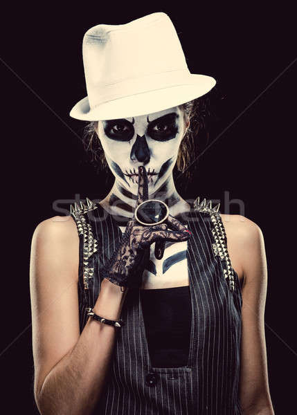Stock photo: Woman with skeleton face art making a hush gesture