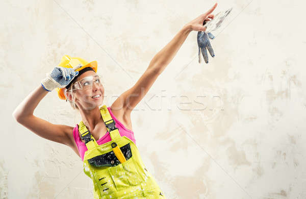 Female construction worker posing over white obsolete background Stock photo © amok