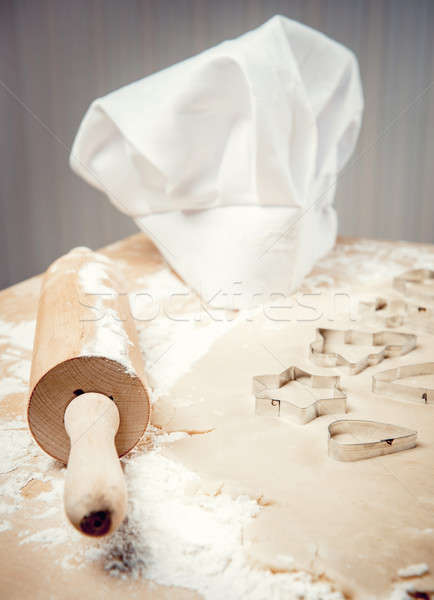 Close-up photo of rolling pin, dough, cookie forms and chef hat Stock photo © amok