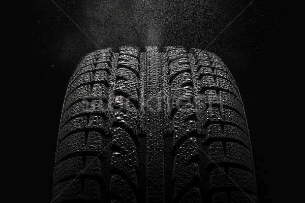 Tire with water drops over black background Stock photo © amok