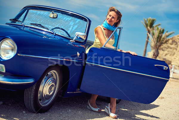 Beautiful woman sitting in retro cabriolet car on the beach Stock photo © amok