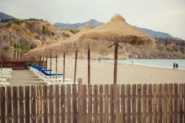 Stock photo: Parasols and empty deckchairs on the Nerja beach.  Spain