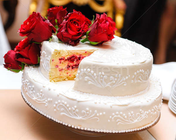 Stock photo: Wedding cake decorated with red roses