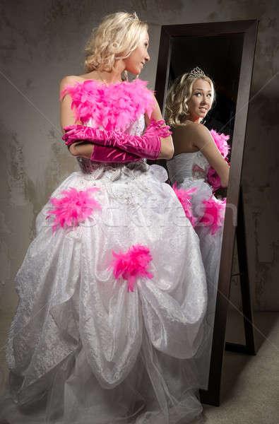Beautiful yong woman wearing bridal dress looking in the mirror  Stock photo © amok
