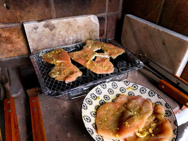 Raw chicken fillet on the single use barbecue Stock photo © amok