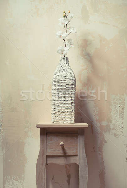 Wooden cupboard with white orchid beside the grunge, beige wall Stock photo © amok