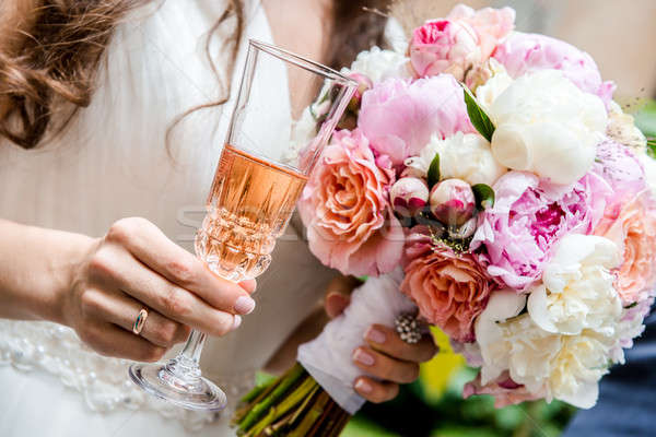 Beautiful bridal bouquet  and glass of champagne close-up Stock photo © amok