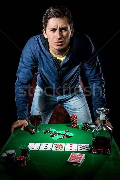 Agressive young gambler indoors Stock photo © amok