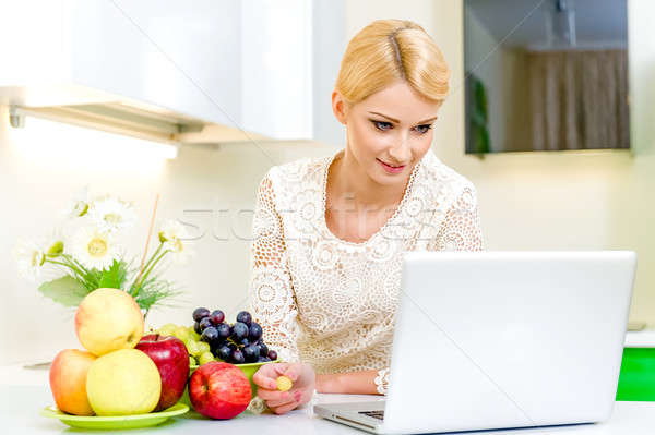 Young woman looking for a recipe on the laptop computer  Stock photo © amok