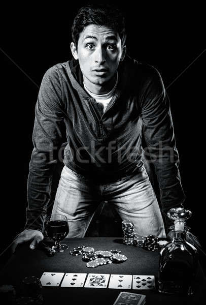 Young gambler indoors, black and white photo Stock photo © amok