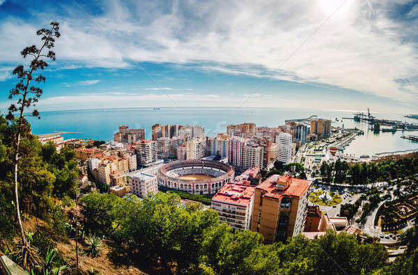 Picturesque view of Malaga bullring (La Malagueta) and seaport.  Stock photo © amok