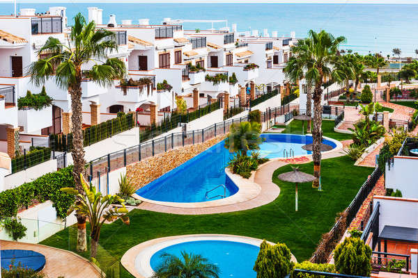 Typical spanish townhouse with a swimming pool near the sea Stock photo © amok