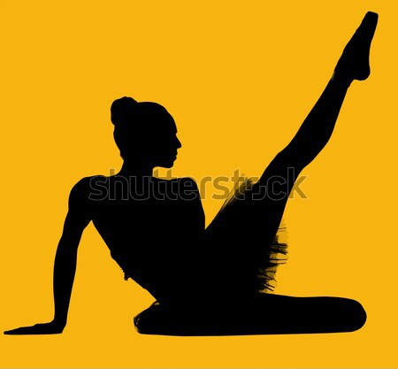 Black silhouette of ballerina isolated over yellow background Stock photo © amok