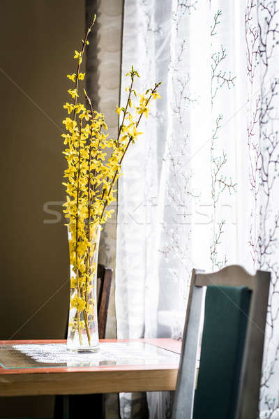 Spring yellow flowers in vase on a table near the window Stock photo © amok