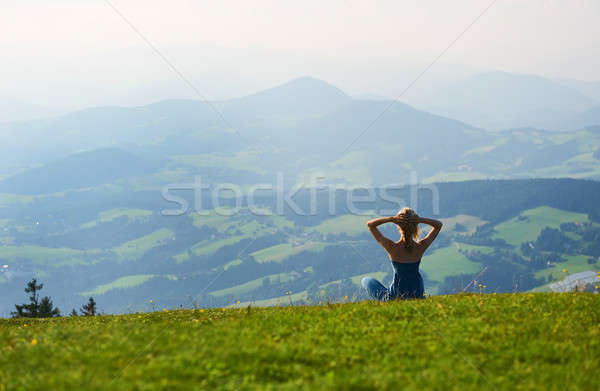 Woman sitting on mountain top. Austria Stock photo © amok