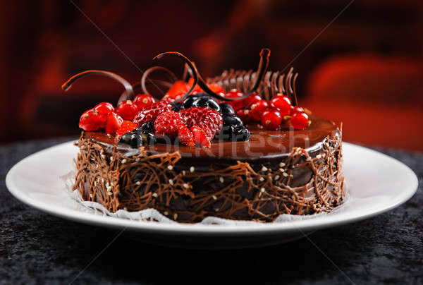Luscious chocolate cake with fresh berries on a plate Stock photo © amok