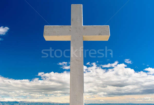 White cross against blue sky and fluffy clouds Stock photo © amok