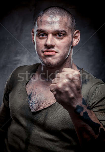 Portrait of young fighter with dirty face and chest Stock photo © amok