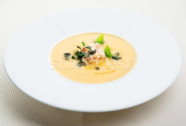 Pumpkin crab soup on a white bowl Stock photo © amok