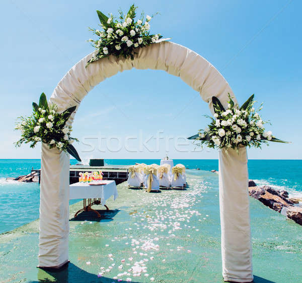 Wedding arch and wedding chairs on the empty beach Stock photo © amok