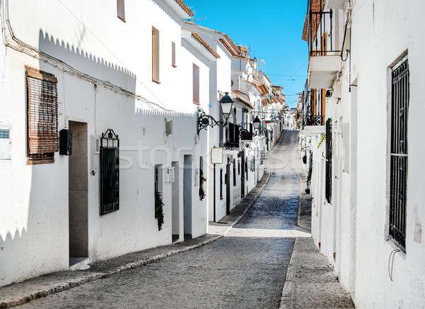 Keskeny utca Spanyolország város gyönyörű hely Stock fotó © amok