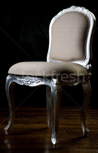 Wooden vintage beige color chair with carved legs Stock photo © amok