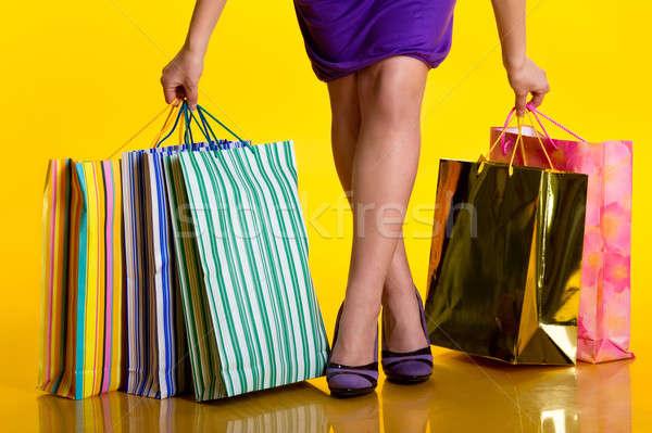 Női kezek tart bevásárlótáskák papír lány Stock fotó © amok