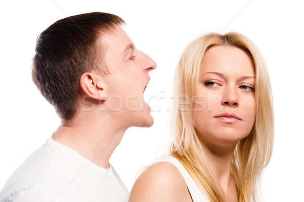 Man screaming at his girlfriend over white background Stock photo © amok