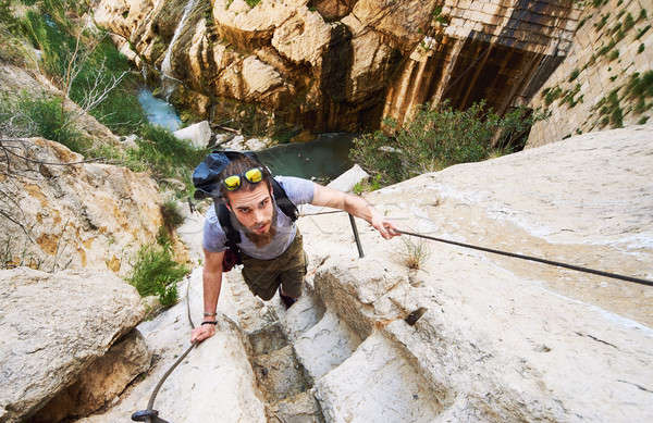 Man traveler climbing up a stepped mountain road. Spain Stock photo © amok