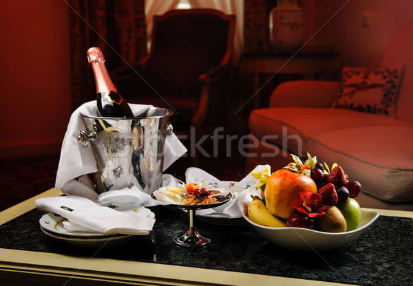Romantic evening with bottle of champagne, sweets and fruits in  Stock photo © amok