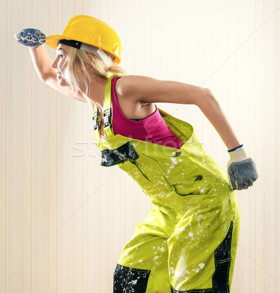 Woman wearing coverall and hard hat posing indoors Stock photo © amok