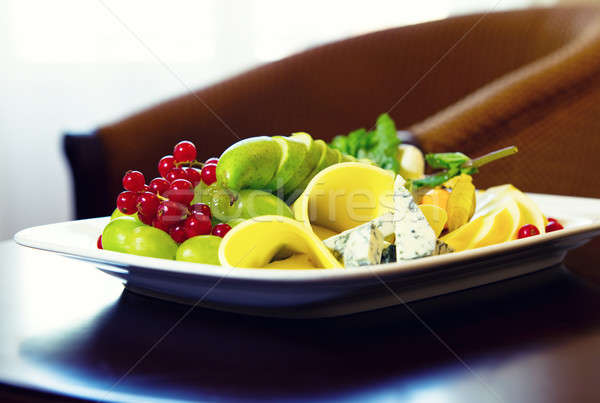 Various types of cheese, grapes and redcurrant closeup compositi Stock photo © amok