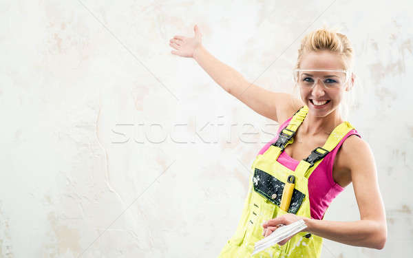 Female construction worker with putty knife  Stock photo © amok