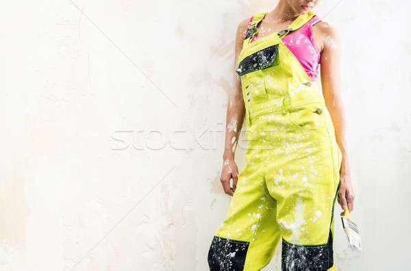 Female in coverall holding paint brush  Stock photo © amok
