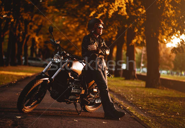 Motorcyclist with a cafe-racer motorcycle outdoors Stock photo © amok